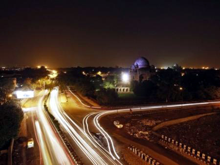 Traffic moves along a busy road in New Delhi
