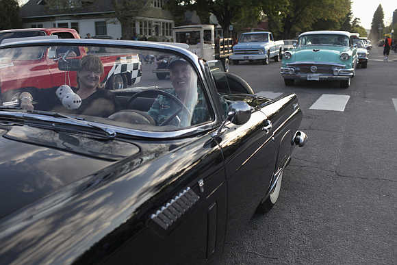 Sandra and Jim Devine from Sagle, Idaho, drive their 1963 Dodge Dart along the 'Lost in the 50's' parade route in Sandpoint, Idaho.
