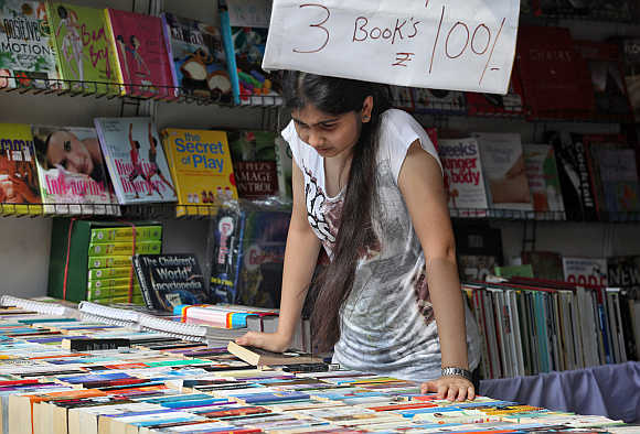 A girl looks at a book stall in Lucknow.