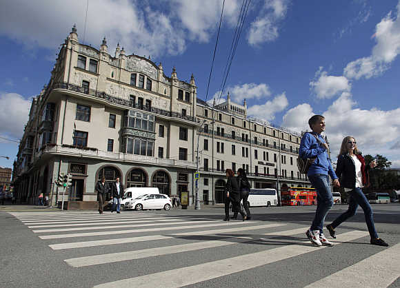 People cross the road near Metropol hotel in Moscow. Photo is for representation purpose only.