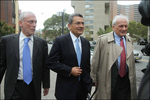 Rajat Gupta, flanked by his attorneys