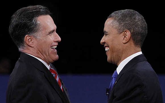 Republican presidential nominee Mitt Romney and US President Barack Obama shake hands at the conclusion of the final US presidential debate in Boca Raton, Florida.