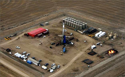 A oil drilling rig operates outside Williston, North Dakota.