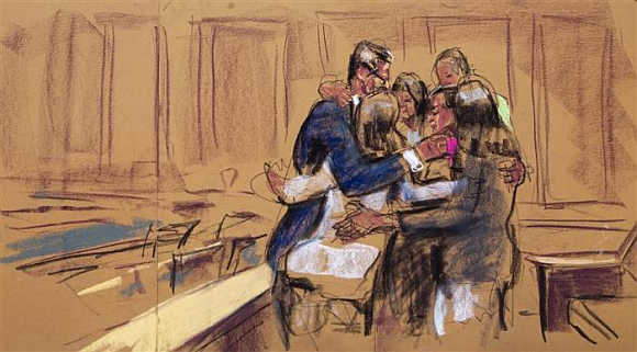 Rajat Gupta is seen hugging his family in this courtroom sketch, in New York.