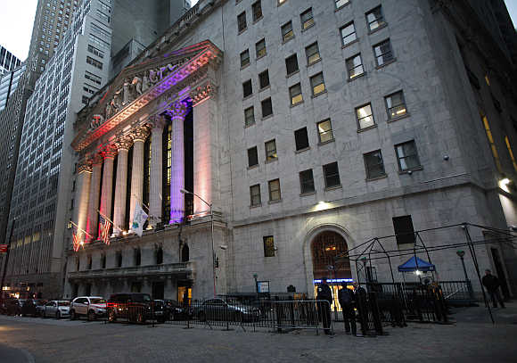 Traders and staff report to work at the New York Stock Exchange.