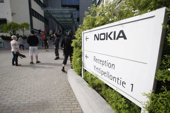 Nokia employees arrive for a personnel briefing in Oulu, Finland.