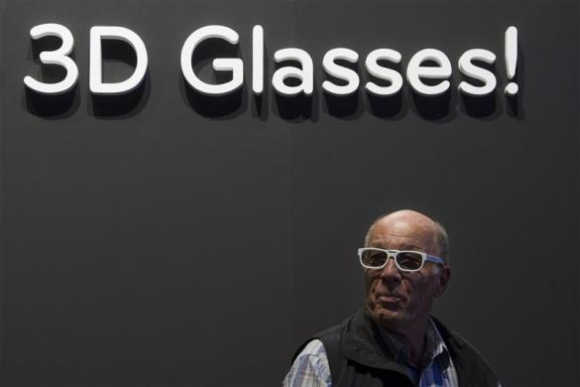 A man wears 3D glasses during a 3D TV presentation in the LG pavilion at the IFA consumer electronics fair in Berlin.