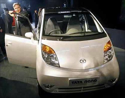 Ratan Tata with the Tata Nano.