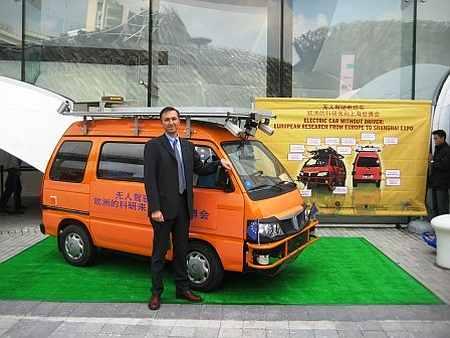 Dr Alberto Broggi and Vislab VIAC solar powered robot car in Shanghai.