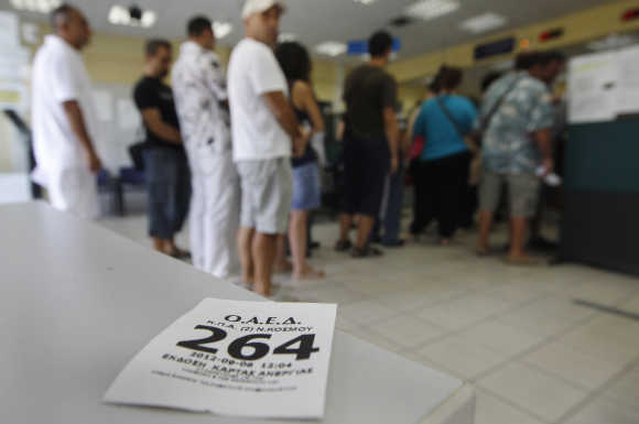 People line up inside an unemployment bureau in Athens, Greece.