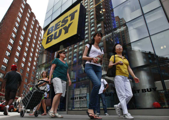 People walk past a Best Buy store in New York.