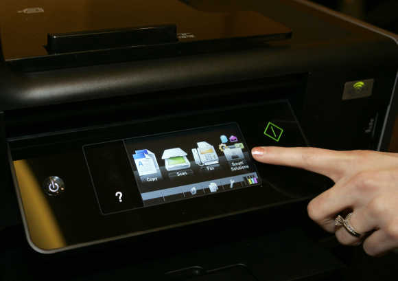 A touch screen menu is displayed on a Lexmark Platinum Pro905 printer in Las Vegas.