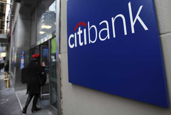 A woman walks into a Citibank branch in New York.