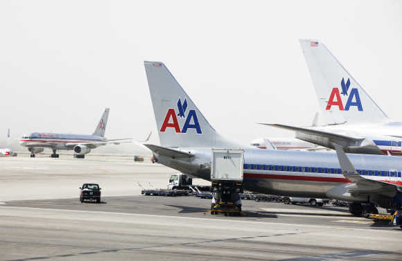 American Airlines aircraft stand on the tarmac at Los Angeles International Airport.