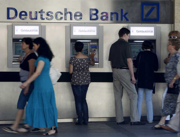 People use ATMs in Munich.