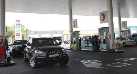 Cars queue for petrol at a station in Dubai.