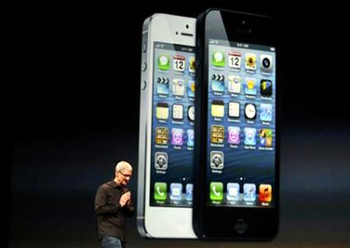 Apple Inc. CEO Tim Cook takes the stage after the introduction of the iPhone 5 during Apple Inc.'s iPhone media event in San Francisco, California.