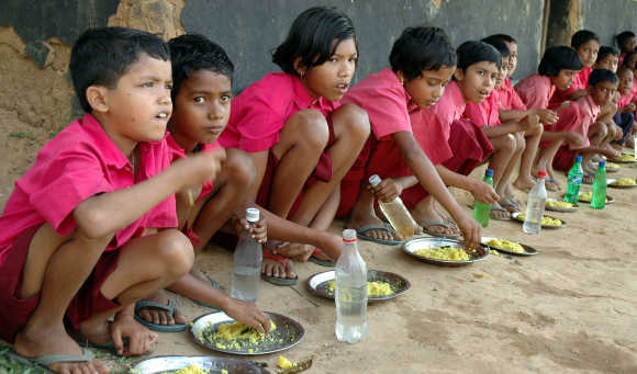 Students eat their free meal in Lambuchara village, about 35km from Agartala, Tripura.