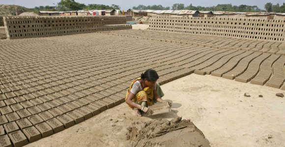 A woman labourer works at a brickyard on the outskirts of Siliguri, West Bengal.