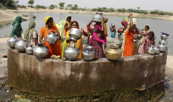 Women gather at a well to draw water at Kayla village, 65km west of Ahmedabad.