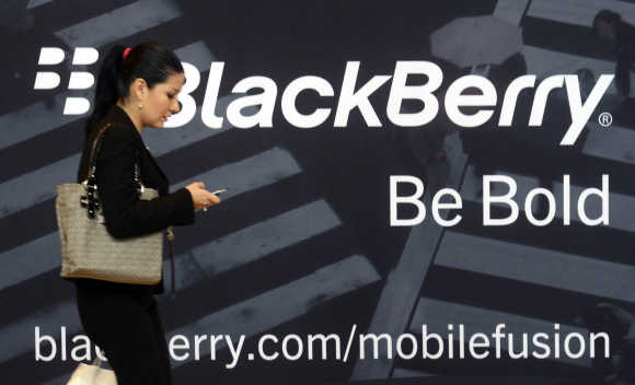 A woman uses her mobile phone at the Blackberry World Event in Orlando, Florida.