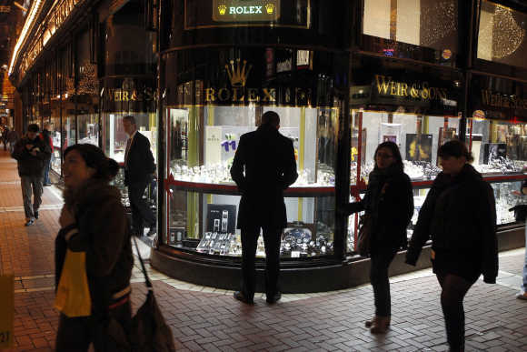 A man looks at a window display of jewellery on Grafton Street, Dublin.
