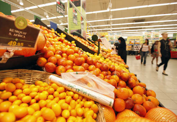 Customers shop near the fruits isle at Carrefour supermarket in Dubai.