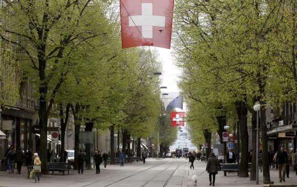 People walk on Zurich's main shopping street Bahnhofstrasse.