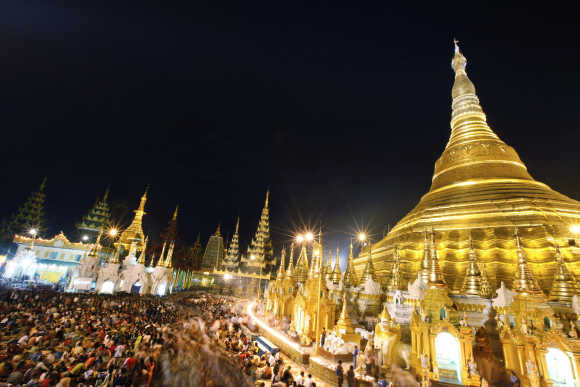 People visit the Shwedagon Pagoda during the yellow robe weaving festival in Yangon, Myanmar.