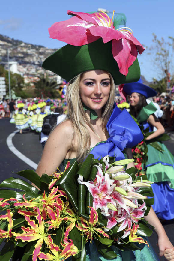 A girl smiles during a parade at Madeira Island Flowers Festival in Funchal, Portugal.
