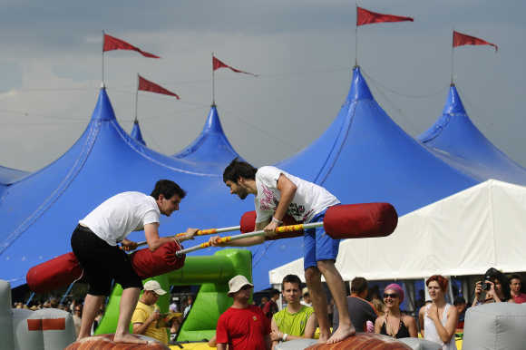 Revellers jostle during a game at the Pohoda music festival at Trencin airport, 130km north of Bratislava, Slovakia.