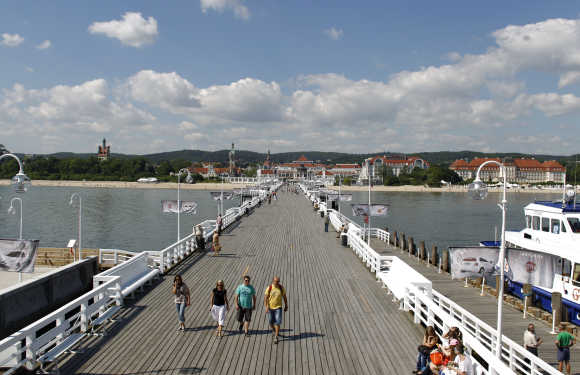 Tourists walk along Sopot pier in Gdansk, Poland.