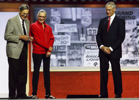 Jim Walton, left, Alice Walton, centre, and Rob Walton, right, in Fayetteville, Arkansas.