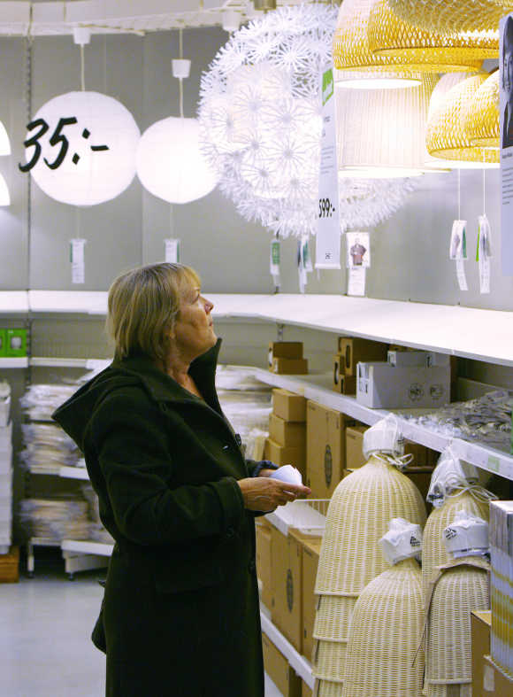 A customer checks lamps at Ikea's store in Malmo, Sweden.