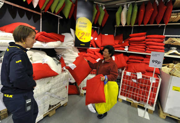 An Ikea employee helps a shopper at the Wembley branch in west London.