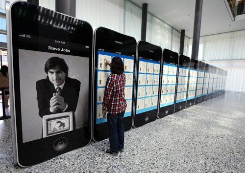A visitor looks at Apple patents displayed at the World Intellectual Property Organization (WIPO) headquarters in Geneva.