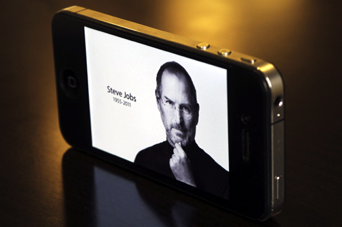 The main Apple Inc website featuring Apple co-founder Steve Jobs is seen on an iPhone in this photo illustration taken in Central Sydney.