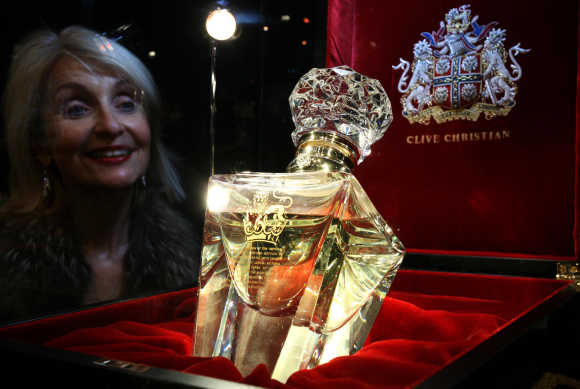 A woman looks at a bottle of 'Imperial Majesty' by Clive Christian, which costs $198,197 for 500ml, in the Roja Dove Haute Perfumerie in Harrods, Knightsbridge, London.
