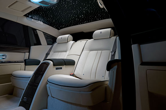The luxurious rear seats of the Rolls Royce Phantom series II with a multi utility centre console.