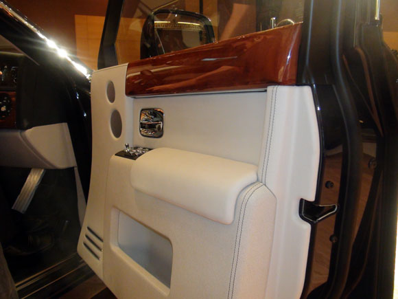 The interior door panel with instrument switches and magazine/storage rack.