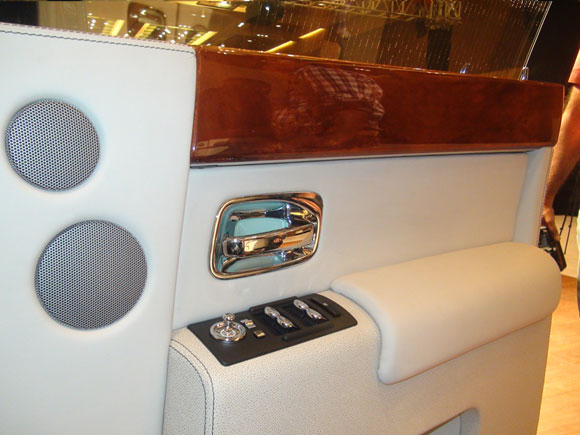 The chrome finish interior door lever and the buttons for the power windows and external rear view mirror.