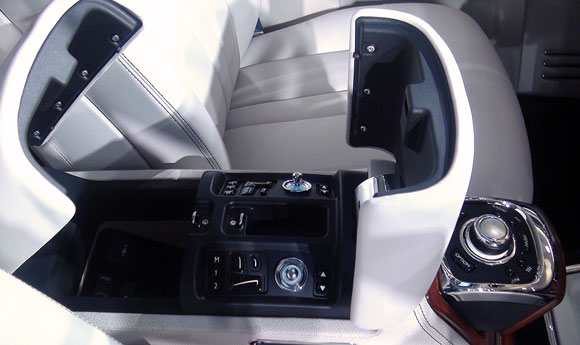 The front centre console (Open) show the utility space and the many electronic buttons.