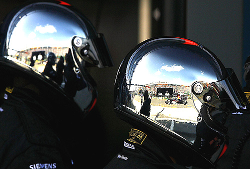 The pit lane is reflected in the chrome helmets of the McLaren Mercedes pit crew during qualifying for the Australian Formula One Grand Prix at the Albert Park Circuit on April 01, 2006 in Melbourne.