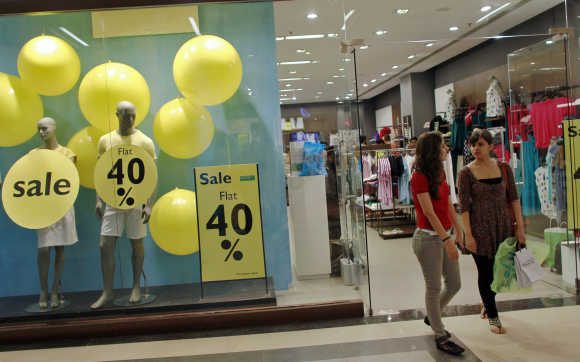 Shoppers leave a retail store inside a shopping mall in Mumbai.