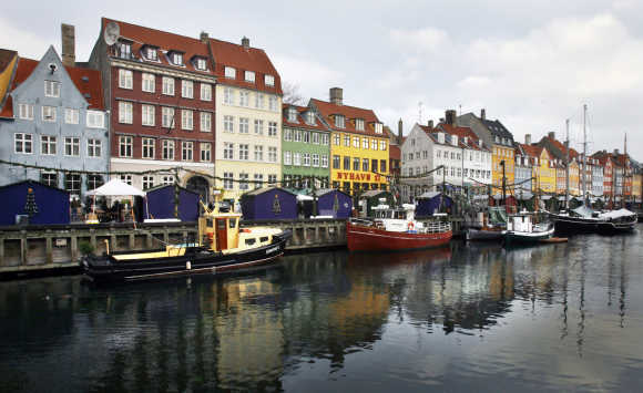 Boats are seen anchored at the 17th century Nyhavn district, home to many shops and restaurants, in Copenhagen.