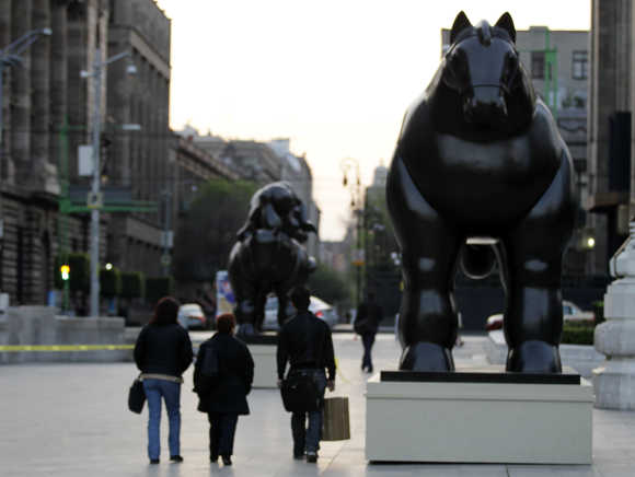 Colombian painter and sculptor Fernando Botero's bronze monumental 'Horse' sculpture outside Mexico City's Palace of Fine Arts.