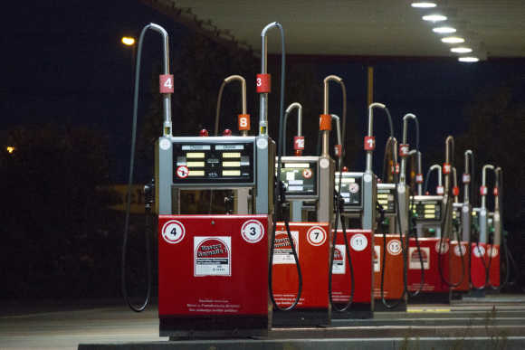 A row of gas pumps is seen at a petrol station in Berlin.