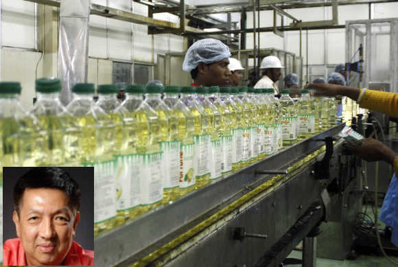 Peter Lim Eng Hock, inset, has a stake in palm oil giant Wilmar.