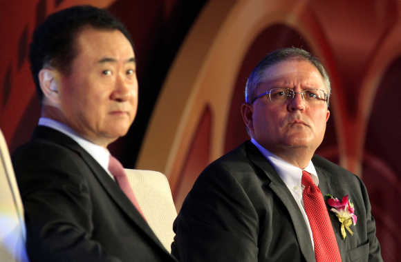 Wang Jianlin, President of Dalian Wanda Group, left, with Gerry Lopez, CEO, AMC Entertainment.