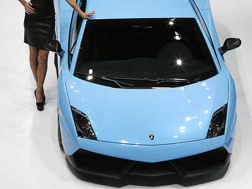 A model poses next to a Lamborghini Gallardo LP570-4 Superleggara